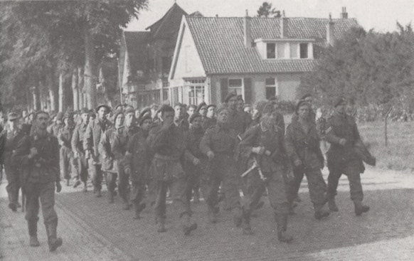 100 men from the 1st airborne being taken towards Germany through Elleson, near Arnhem
